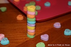 "Stack It! How many candy hearts can you stack before they tumble? Great Valentine's Day game!  My first thought of this game when I heard it was used for preschoolers one year was "" Ok, I know they're just kids but Gees mom isn't that lazy and exploitive of their naturally easy to please little minds?"""