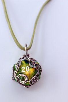 Wire-wrapped D20 green & yellow dice necklace