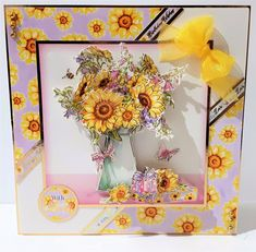This beautiful Sunflower Birthday Card is created using 3D Decoupage techniques.  The central image of the flowers in the jug is layered multiple times to give depth to the card.  The flower petals are also shaped to give them life. The banners on the card say Birthday Wishes making this perfect for a flower lover or a spring/summer flowers.  Definitely a ladies card with the pastel colour tones. It is made from 300gsm heavy weight card stock from Hunkydory Crafts. By shopping with us today… Birthday Wishes, Birthday Cards, Sunflower Cards, Hunkydory Crafts, Burnley, Box Frames, Summer Flowers, Flower Petals, Pastel Colors