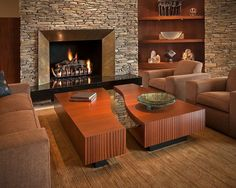 Contemporary Living Room with stone fireplace, Built-in bookshelf, High ceiling, Carpet