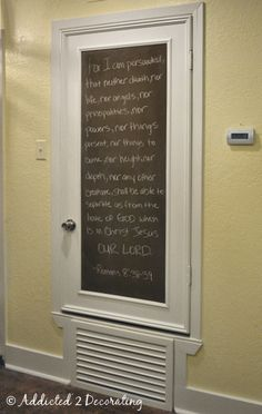 Turn an ugly hollow core door into a pretty framed chalkboard.