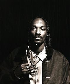 """""""Snoop and I shot together for album covers, movie posters, merchandise, etc. It seems like a dream, but I still can remember being in the studio with Dre when Snoop jumped into the recording booth for The Chronic."""" -Michael Miller"""