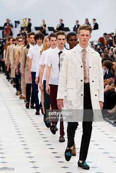Models walk the runway at the Burberry Prorsum show during The London Collections Men SS16 at Kensington Gardens on June 15, 2015 in London, England.