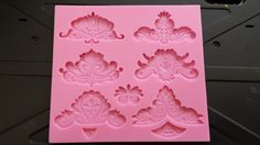 Check out this item in my Etsy shop https://www.etsy.com/listing/184237863/silicone-flourish-mold-fondant-mold-gum