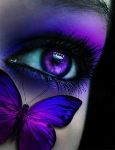 Gorgeous makeup and a beautiful shot. The purple iris is a cool touch as well…
