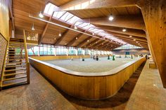 At first we thought this was a large luxury Swedish style spa, but it's even better! A gorgeous arena with ample room for you and your horse to train! Dream Stables, Dream Barn, House With Stables, Luxury Horse Barns, Estilo Tudor, Horse Barn Designs, Horse Arena, Horse Barn Plans, Horse Property