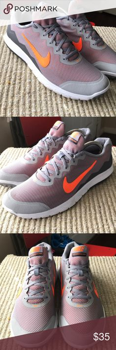 Nike Flex Experience RN4 in size 11.5 woman's. Nike Flex Experience RN4 in size 11.5 woman's. These were my shoes and I have only worn them a few times. These Nikes are in very good condition stills colors are grey and Florescent orange. Nike Shoes Athletic Shoes