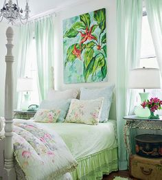 Mint Green + Pink Soft pastels make this master bedroom a dreamy retreat. Mint green curtains and bed linens pop against crisp white-painted walls. Splashes of pink throughout the space lend contrast and give the bedroom feminine flair. Decor, Green Curtains, Home, Green Color Schemes, Vintage Color Schemes, Coastal Bedrooms, Bedroom Color Schemes, Bedroom, Tropical Bedrooms