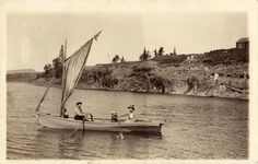 https://flic.kr/p/6qqK4s | Boat on river, with man, woman, and small child,  circa 1910 | Scanned real photo postcard