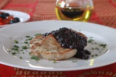 Pork with Blueberry Sauce. Blueberries are in season! Use them up by making this sauce that's sweet delicious and easy to make! Blueberry Sauce, Blueberry Recipes, New Recipes, Favorite Recipes, Good Food, Yummy Food, Boneless Pork Chops, Soups And Stews, Stuffed Peppers