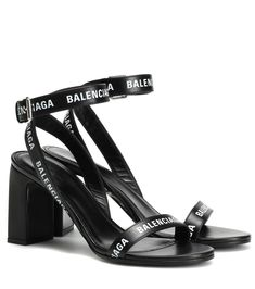 Accent your warm-weather wardrobe with these sleek sandals from Balenciaga. Crafted in Italy from smooth black calf leather, this pair has a supportive slingback ankle strap and is printed allover with the brand's name for a . Leather Wedge Sandals, Leather Ballet Flats, Suede Sandals, Calf Leather, Leather Sandals, White Leather, Skinny Leather Pants, Rubber Sandals, Glitter Sandals