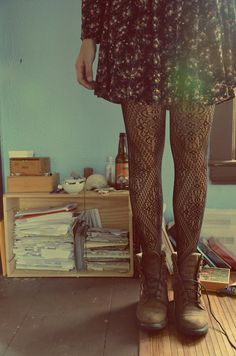 dress + patterned tights + boots. Making clashing work. Making big boots girly.