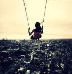 I seriously used to have dreams where I was in the sky on a swing looking over the city. It was just like this picture.