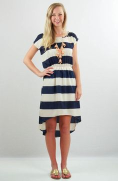 This dress just FEELS like summer under the sun! Bold navy stripes are bright and fun, and the open scoop back shows off a touch of skin. This dress is just so nautical and perfect for those beach days!