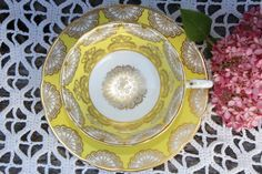 Item: Gorgeous footed tea cup and saucer  Color: White, yellow and gold  Mark…