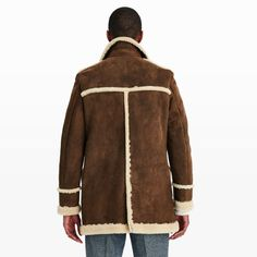 With a history that started over 200 years ago, Crombie remains an iconic British brand, trusted for the quality of its products and the timeless elegance of its designs. Crafted in Italy, this supple shearling coat features a traditional Caban shape and a single-breasted construction with three-button closure and panel detailing. Offering exceptional warmth and comfort, this is a modern classic to invest in. Lamb shearling Straight fit 33 &fra