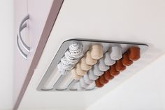 Store and dispense your coffee capsules conveniently with the Abacus Pod Rack
