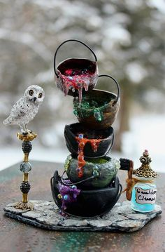 Witch or Wizard Shop Mucky Cauldron Tower with Cauldron Cleaner and Snowy Owl. $60.00, via Etsy.