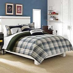 Bring a cool and casual look to your bedroom with the Nautica Blake Comforter Set. The handsome bedding features a shirting plaid design in tones of blue complemented by accents of hunter green on an ivory ground.