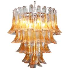 Murano Glass Saddle Form Chandelier | From a unique collection of antique and modern chandeliers and pendants  at http://www.1stdibs.com/furniture/lighting/chandeliers-pendant-lights/
