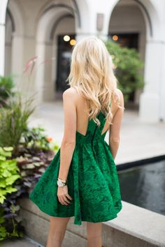 {Green embroidered dress.}