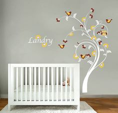 Kids swirl tree vinyl wall decal with birds flowers and Childs name letters cute for any nursery. $85.00, via Etsy.
