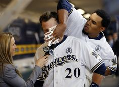 Milwaukee Brewers Jonathan Lucroy gets a pie in the face from teammate Carlos Gomez during a post-game interview after an opening day baseball game against the Colorado Rockies, on April 1, 2013, in Milwaukee. (Photo: Jeffrey Phelps / AP) #Baseball #OpeningDay #MLB