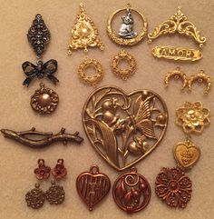 Work Table Wednesday 2/28/18 ~ Playing and musing with some of my stampings from B'Sue Boutiques. The big heart has lily of the valley flowers, my Mom's favorite; I want to paint two of them for my sister and me.  The stampings include B'Sue by 1928 pewter with Gingerbread and Rusted Iron finish, and B'Sue Boutiques brass with Silverware fine silver plate and Classic Gold Plate finish.  The sacred heart medallion is from my stash.
