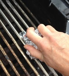 How to Clean the BBQ Grill in a SNAP! by Jennifer Horrocks. Turn BBQ on to normal temp then turn off. Make a ball of aluminum foil, dip in water then sprinkle baking soda on ball then scrub grill once clean oil the grill.