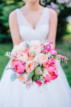 Gorgeous bright coloured bouquet- Juliet roses, ranunculus, poppies, coral charm peonies, sweet peas, and hydrangeas