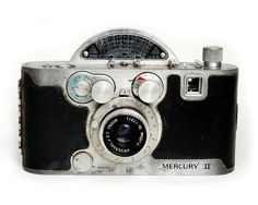 The Mercury II was a rock solid magnesium rangefinder produced by the Universal Camera Corporation in 1945. A 35mm half frame camera, it featured a metal rotary focal plane shutter which accounts for the odd protrusion on top. It boasted the fastest shutter of it's day, with speeds of 1/20 - 1/1000 sec. The lenses are interchangeable.