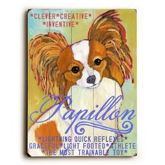 Papillon Wood Sign This Papillon wood sign by Artist Ursula Dodge is sure to bring style to your space and a smile on your face. The sign is a hand distressed planked wood design made of birch wood. T