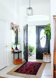 Spotlight on Layered Rugs Design Trend! Tons of design inspiration & examples of how to use layered rugs in any room in your home to add texture and style. Home, Entrance Hall, House Entrance, Entryway Rug, Living Room Carpet, Layered Rugs, House Interior, Hall Rugs, Interior Design