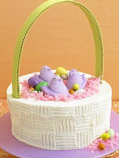 Take some help from boxed cake mix for our Easter-Basket Cake. It will look so impressive on your #Easter table! http://www.parents.com/holiday/easter/recipes/delicious-spring-desserts/?socsrc=pmmpin130212HnCEasterBasketCake#page=12