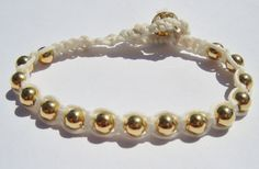 Gold plated Wrap Bracelet on Off White/Cream Waxed by dzinebug. €18,00, via Etsy.