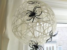 make a yarn spider web ball for Halloween - Craftberry Bush