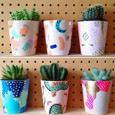 Paint your plant pots with bright and colourful patterns to give your cacti a fun new home!