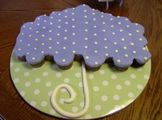 "Baby Shower Umbrella Cupcake cake - Green and purple cupcake cake to match the plates the mom-to-be found on-line.  This was for a couples' shower so she didn't want anything too ""girly"" or ""babyish""!  Hazelnut biscotti buttercream with fondant handle."
