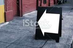 color photo plack and white arrow on sandwich board sign stock ...