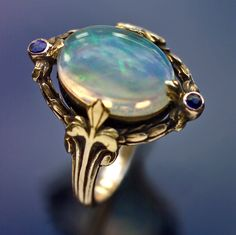 SIBYL DUNLOP  Arts & Crafts Ring   Gold Water Opal Sapphire  H: 1.8 cm (0.71 in)   British, c.1920