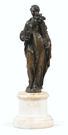 A probably Italian 17th/18th century bronze Statuette of Cérès holding a sheaf of wheat and a horn     sotheby's
