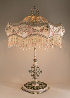 Victorian lampshade with roses and antique lace beautiful lamps antique table lamp with flowers is hand painted and holds an ivory carousel silk lampshade the shade is covered in a luxurious edwardian era ivory silk mozeypictures Gallery