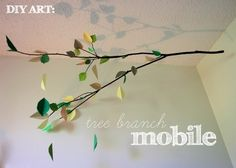 leaf mobile, using a real branch.  Would look especially cool with tree mural on the wall