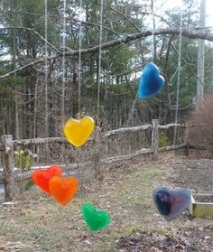 The Enchanted Tree: Hanging Ice Hearts ((HANG THESE FROM THE TREES AT WINTER!)) We turned some of our ice hearts into a rainbow heart mobile. The individual hearts spin, and the bottom branch spins as well. It's fun to watch it move as the wind blows it gently. The bright colors bring some much needed color to the dark days of winter.