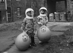 thekhooll: Space Hopper Astronauts Boys in a Glasgow back court show off their Christmas presents, which include astronaut suits and Space Hoppers Source: Century of the Child: Growing by Design, (MOMA) Vintage Photography, Street Photography, Old Photos, Vintage Photos, Fotografia Social, Foto Art, We Are The World, Retro Futurism, Museum Of Modern Art