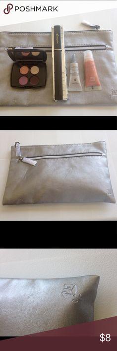 Lancôme Gift Set. 💕Price is Firm💕 Include silver make up bag, mascara, lip gloss, lifting eye serum and eyeshadow. Lancome Makeup Eyeshadow