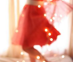 red skirt and twinkle lights (via design mom)