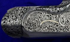 Engraver: Phil Coggan (UK)   Holland and Holland