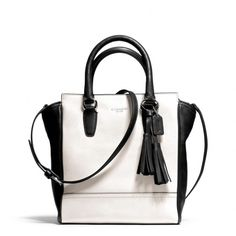 I am *always* a fan of black and white color-blocking!  The Legacy Mini Tanner Crossbody In Two Tone Leather from Coach