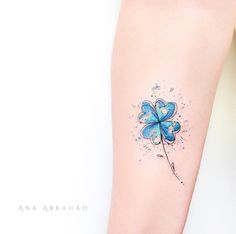 Blue four-leaf clover tattoo by Ana Abrahao